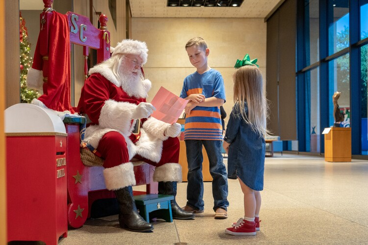 Two kids with Santa