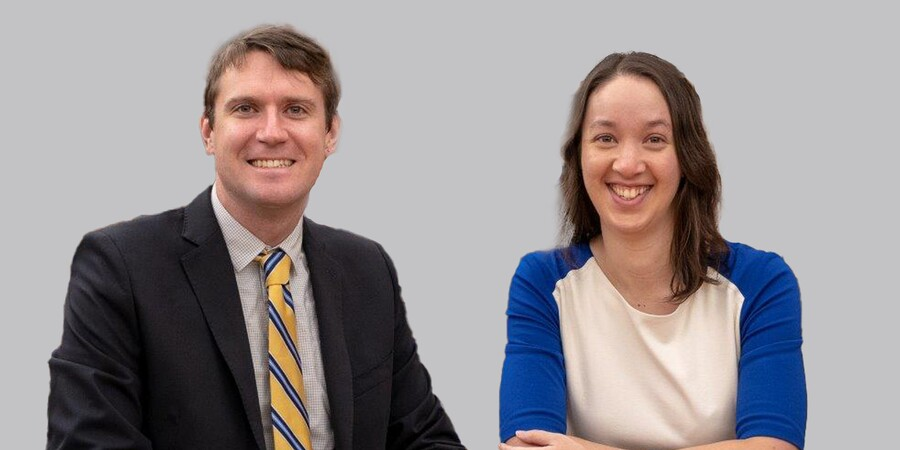 Headshots of a man and woman. The smiling man has brown hair, blue eyes, is wearing a dark jacket, blue-checked shirt, and blue and yellow tie; the smiling woman has shoulder-length brown hair and is wearing a shite shirt with blue sleeves.