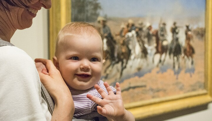 baby in front of a western painting at the Amon Carter Museum