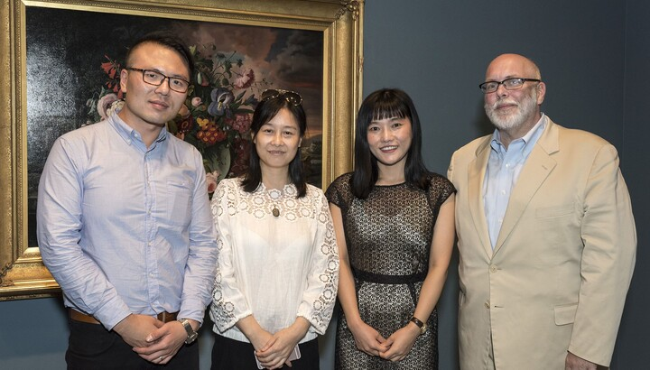 Director Andrew Walker with three scholars from Nanjing University