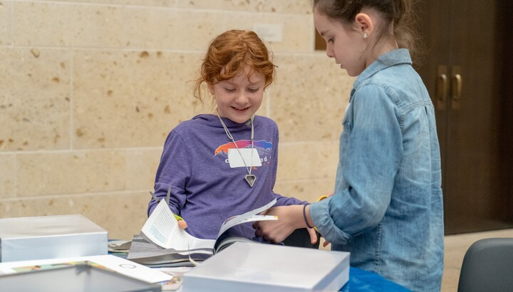 two girls participating in a homeschool class