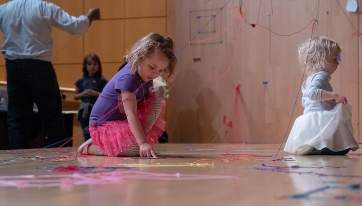 two girls making art on a stage