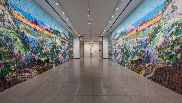 Mural made out of colored pinata paper in a hallway