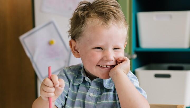 little boy coloring portraits