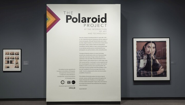 Exhibition title wall featuring introductory text on a white panel. To the right is a framed photo collage portrait of a man; to the left is a framed contact sheet.