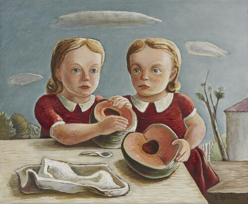 twin girls with melon on a table outside