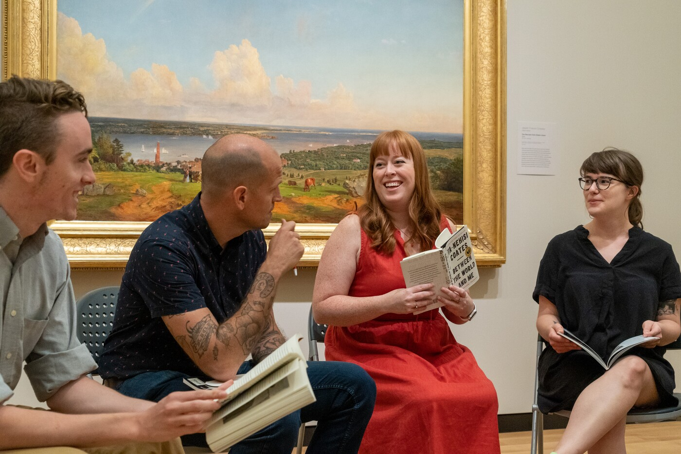book club reading in an art gallery