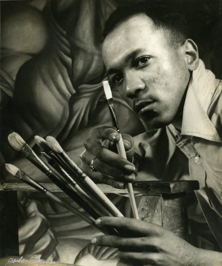 "Charles White in front of his mural ""Chaos of the American Negro"", 1941"