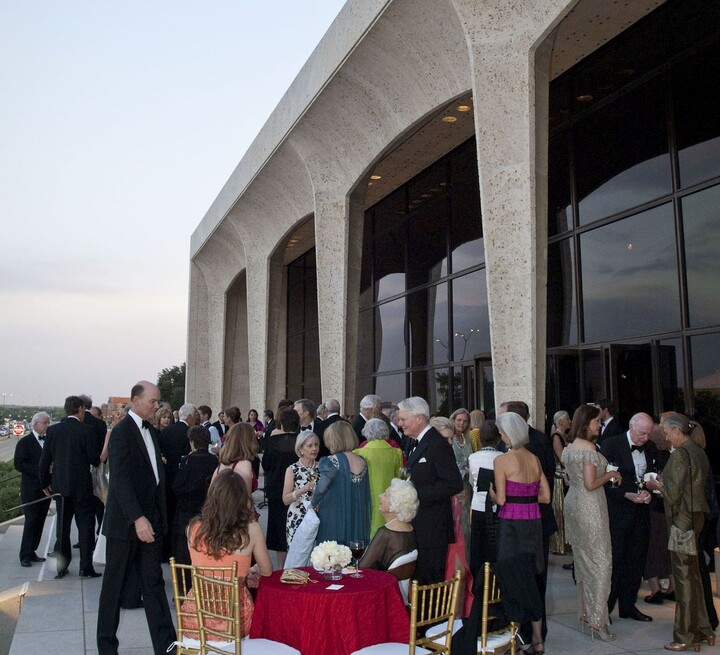 Black tie gala on porch of the Carter
