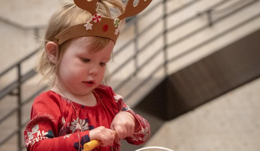 little girl wearing antlers