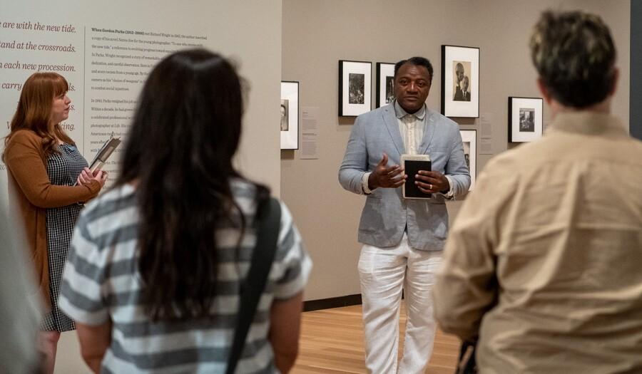 Man giving a tour in Gordon Parks exhibition
