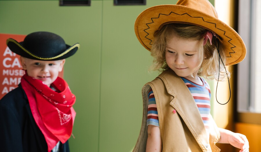 little boy and little girl playing dress up